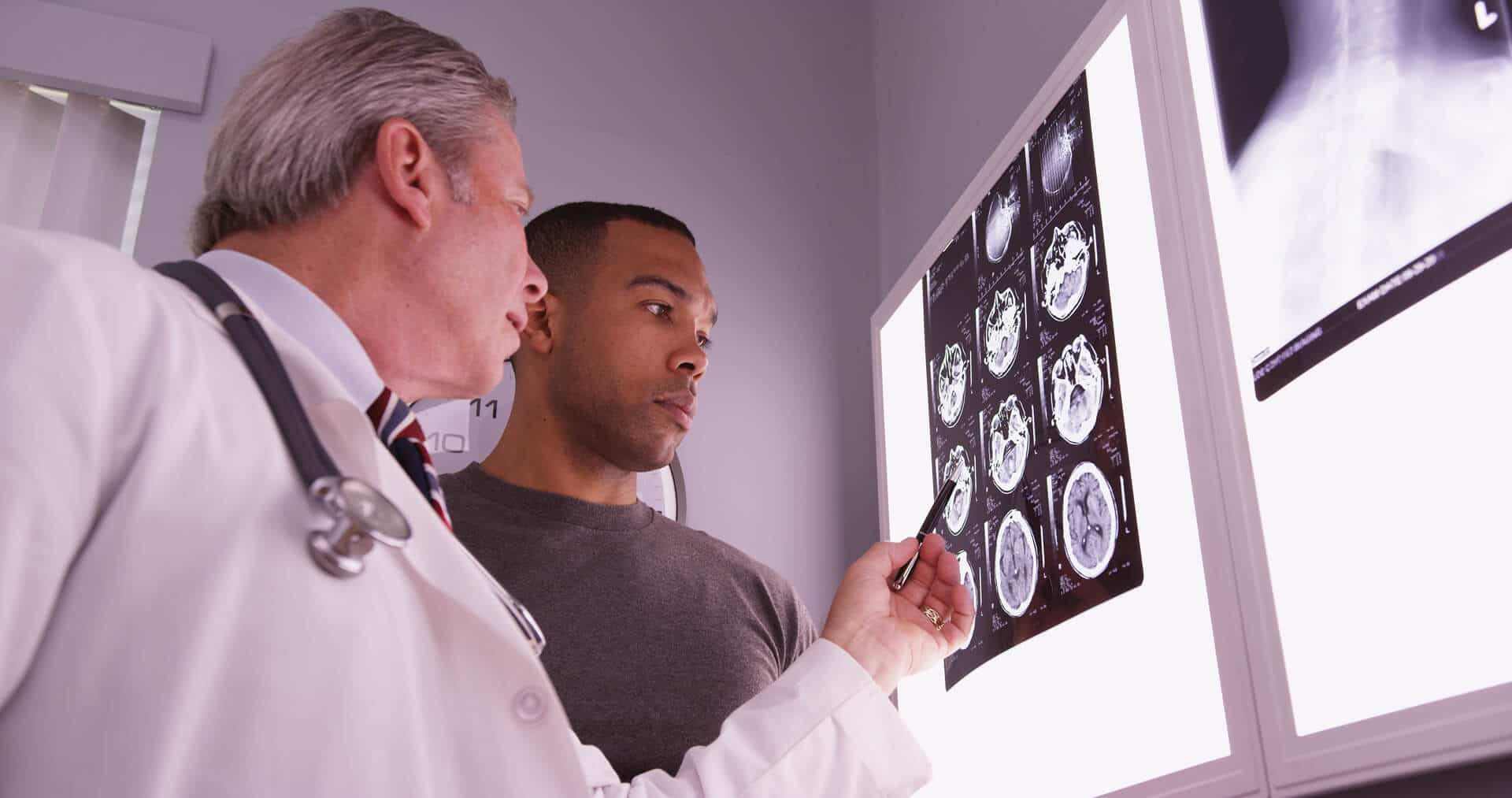 Doctor Explaining Traumatic Brain Injury To Patient